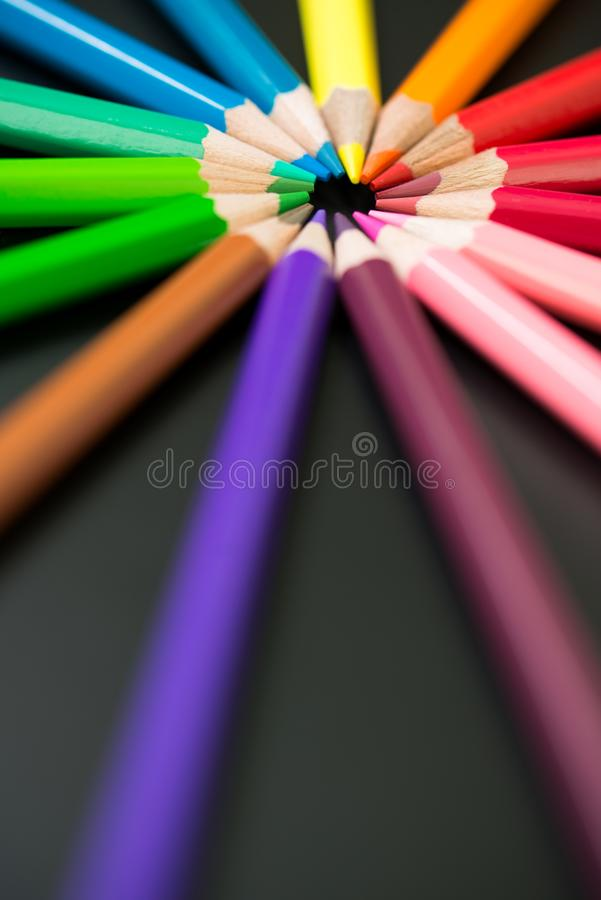 Color pencils arranged in circle royalty free stock photography