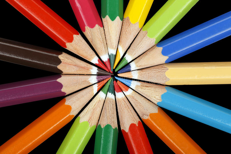 Color pencils. On black forming a circle stock image