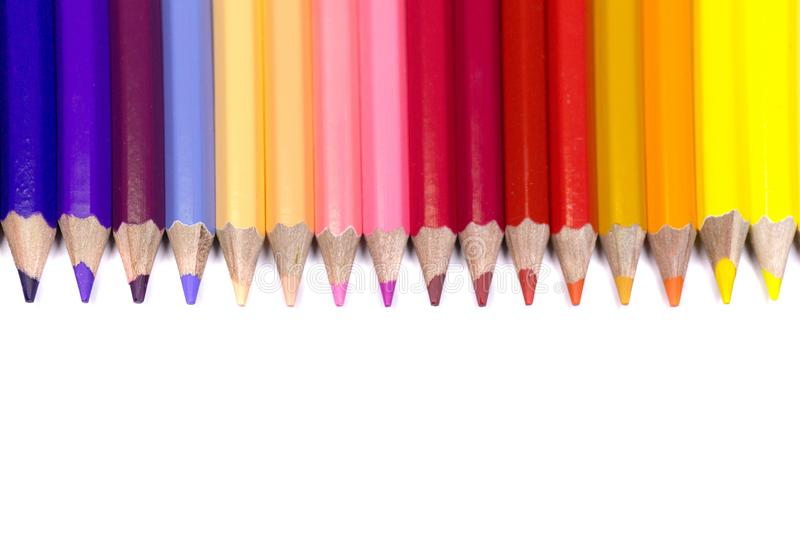 Color Pencils Facing Down on Pure White Background in Straight L stock photo
