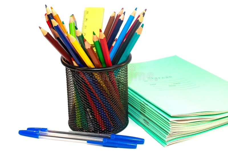 Color pencils and notebooks for school isolated on white. Background royalty free stock photo
