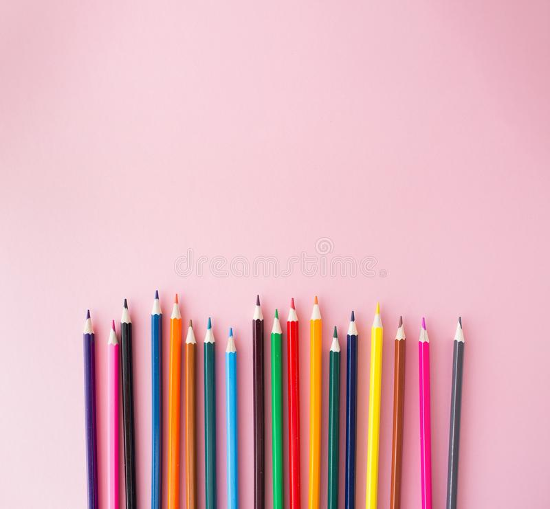 Color pencils on pink background close up with Clipping path..Color pencils for drawing Rainbow. Copypaste, flat lay.  stock image