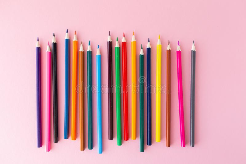 Color pencils on pink background close up with Clipping path..Color pencils for drawing Rainbow. Copypaste, flat lay.  stock photo