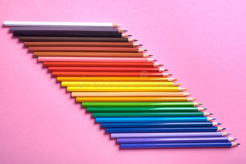 Color pencils on pink pastel background, close up. Set of colorful pencils, copy space. Crayons. Top view, flat lay. stock images
