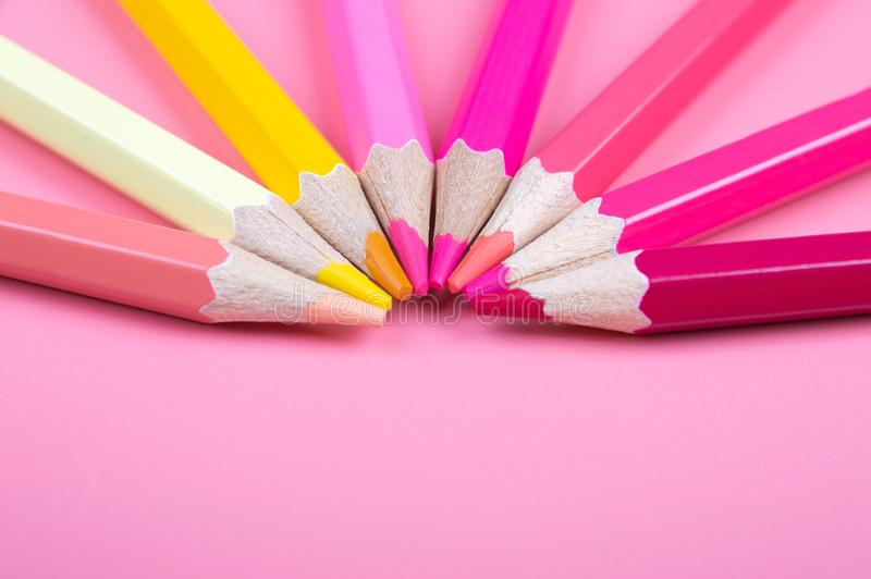 Color pencils on red background. Color background concept stock photos