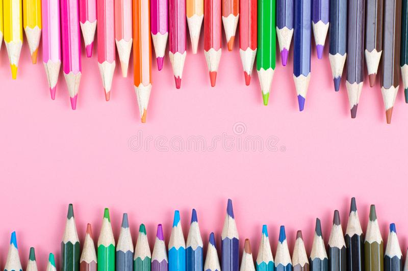 Color pencils on red background. At color background concept royalty free stock images