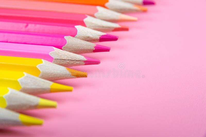 Color pencils on red background. At color background concept royalty free stock image