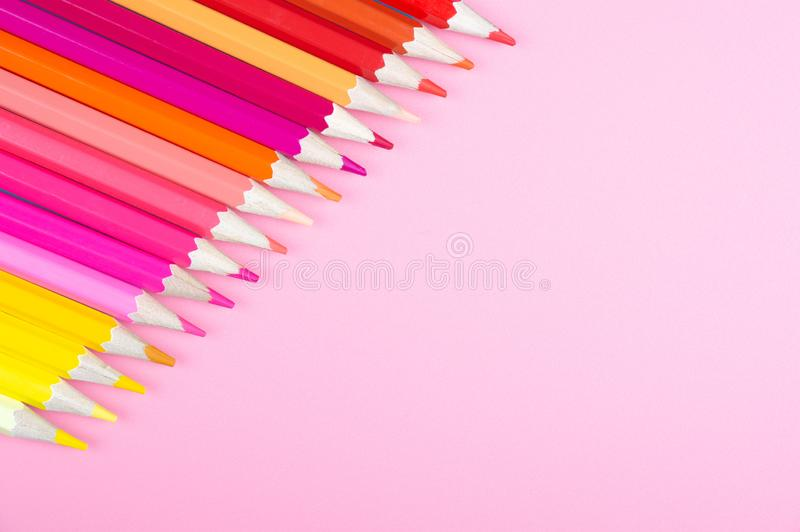 Color pencils on red background. At color background concept royalty free stock photos