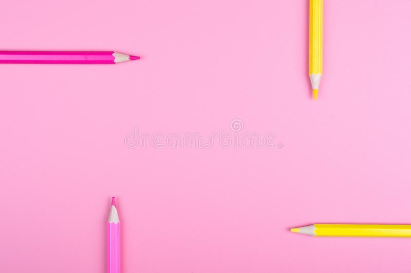 Color pencils on red background. Color background concept stock photo