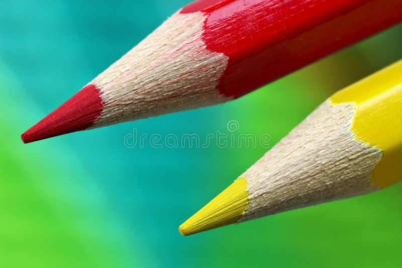 Color pencils on a rulers background royalty free stock photography