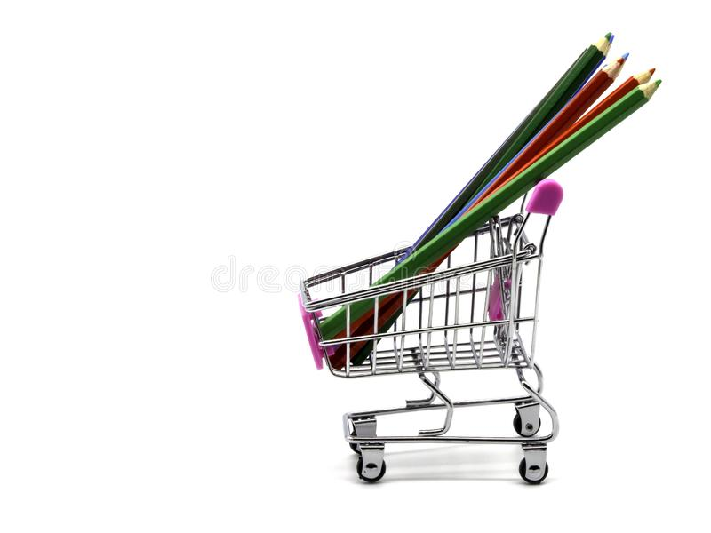 Color pencils and shopping cart isolated and white background stock image