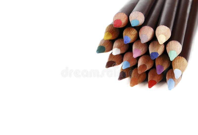 Color pencils with space for text, white background. Texture wood colored pencils. Colored pencils macro. DOF. royalty free stock photos