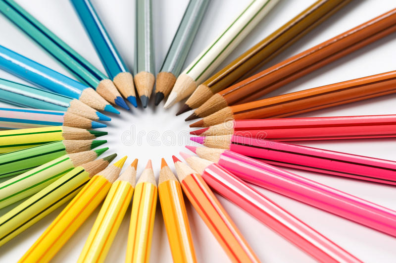 Color pencils wheel. Color pencils in arrange in color wheel colors on white background royalty free stock photos