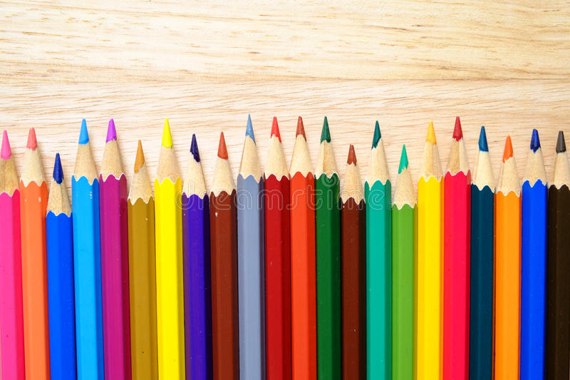 Color pencils on wood background stock images