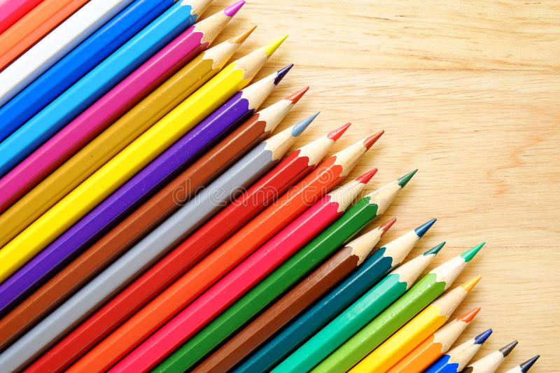Color pencils on wood background royalty free stock photos