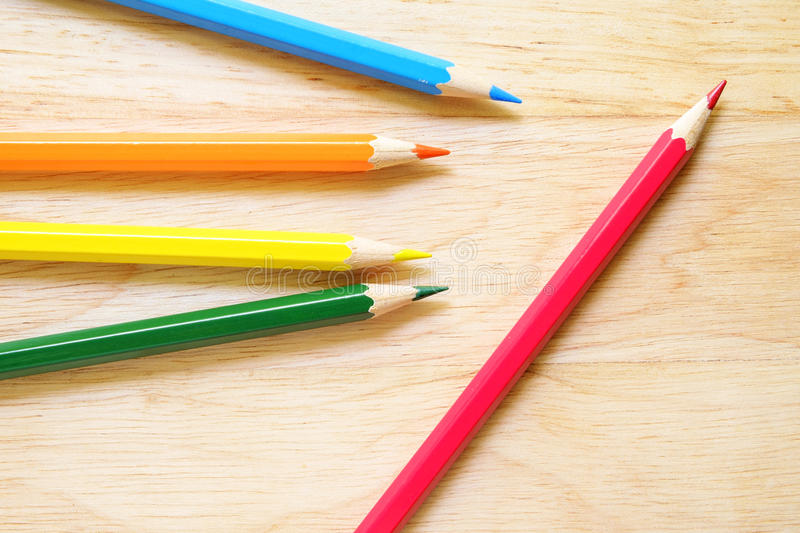 Color pencils on wood background stock image