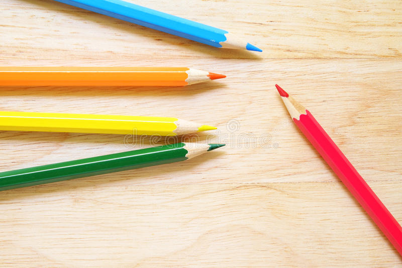 Color pencils on wood background royalty free stock photo