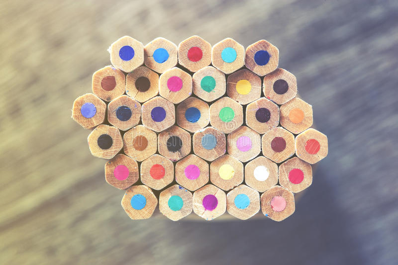 Color pencils. On wooden desk royalty free stock photo