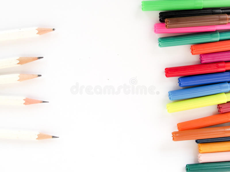 Color pens lined up with white pencils stock images