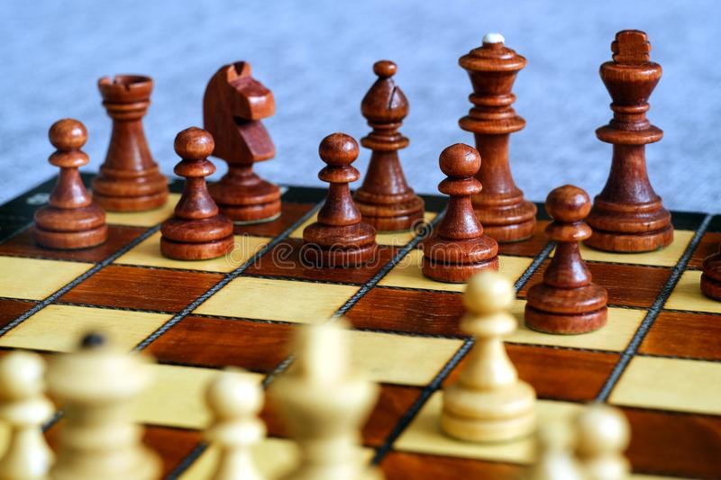 Color photo of chess Board and chess pieces, wooden chess pieces on the chessboard. Soft focus. royalty free stock images