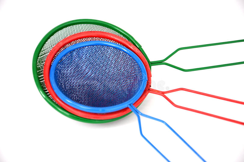 Color and photography concept. Picture of a red , green and blue tea strainers stock photography