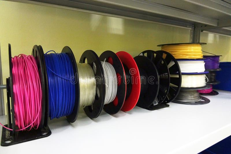 Color PLA and ABS plastic filament coils for 3D printer. royalty free stock photography
