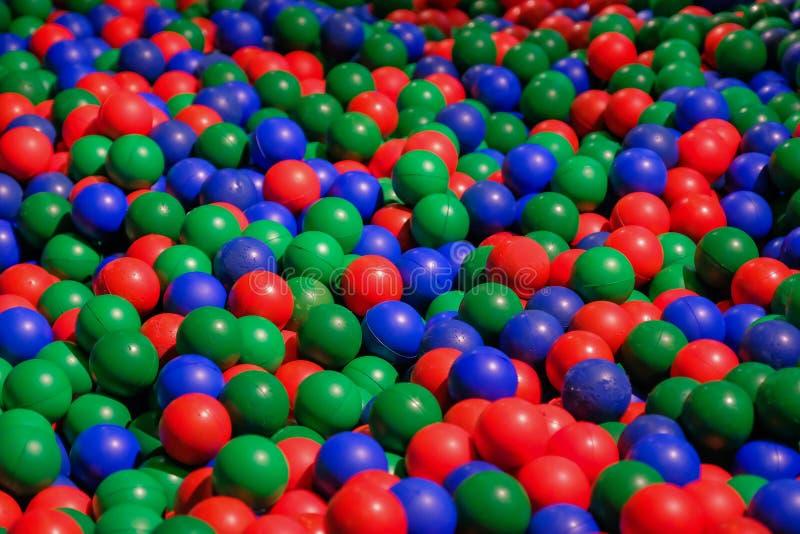 Color plastic balls on children playground stock images