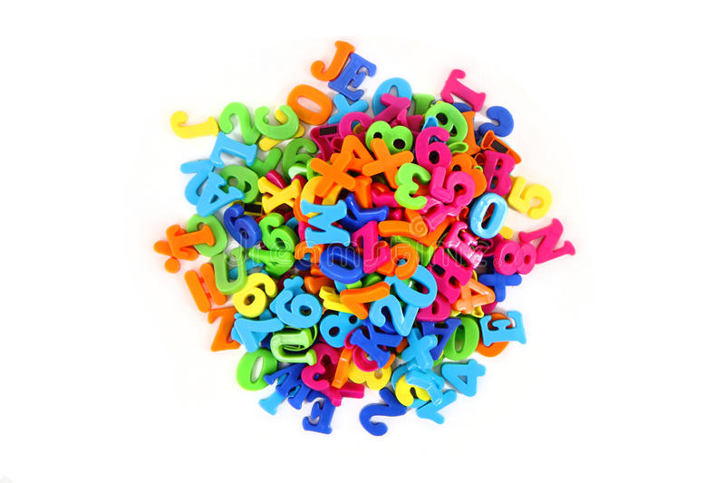Color plastic letters. Isolated on the white background stock photo