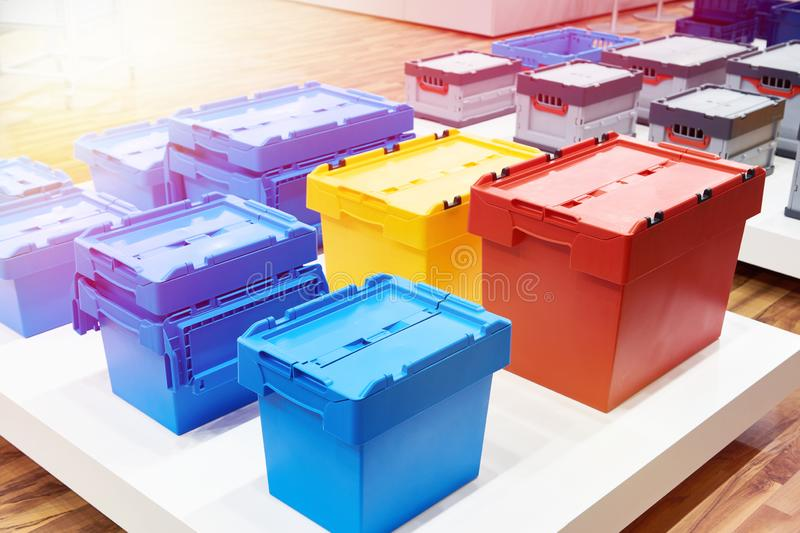 Color plastic boxes in hardware store stock photo