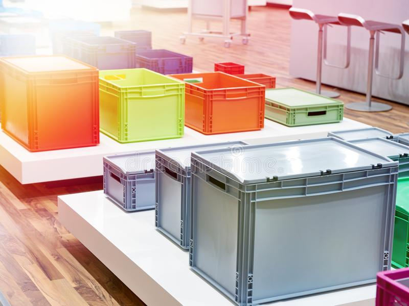 Color plastic boxes in hardware store royalty free stock photography
