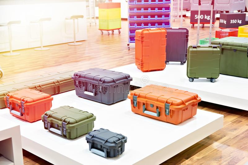 Color plastic boxes in store royalty free stock photo
