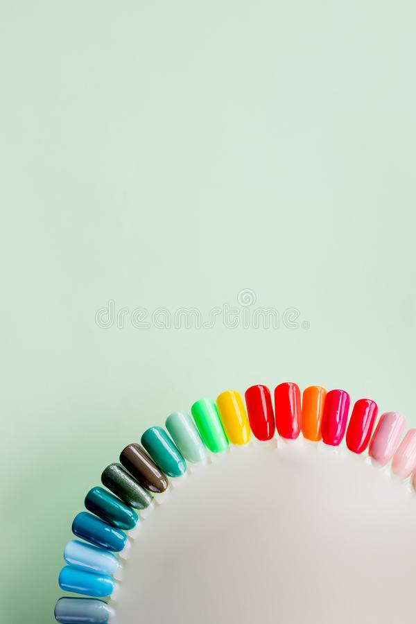 The color of Polish for manicure. design for nails. testers nail Polish on pastel background.Fashion manicure. Shiny gel royalty free stock images