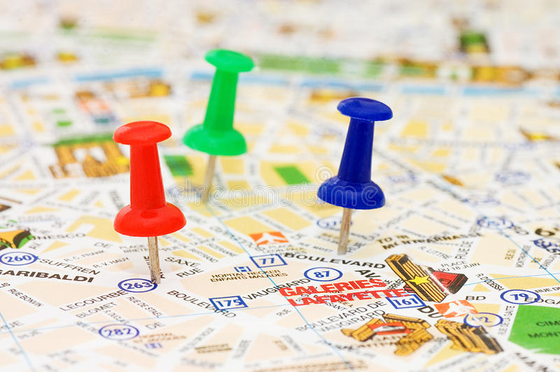 Color pushpins marking a location stock photo