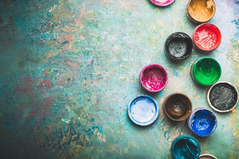 Multicolored Paint Cans on wooden background stock photos