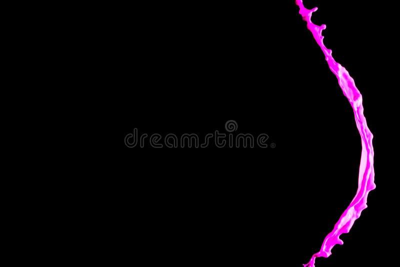 Color rosado abstracto del chapoteo de la pintura en fondo negro fotografía de archivo