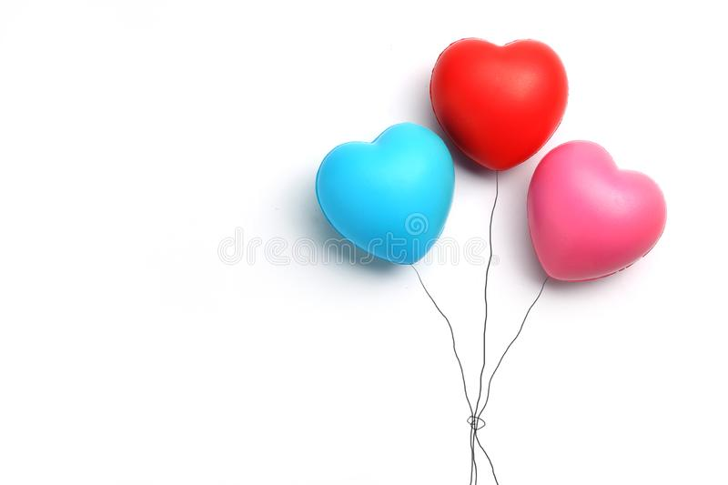Color rubber hearts balloons creative photography isolated on white background,Valentine`s Day concept stock photography