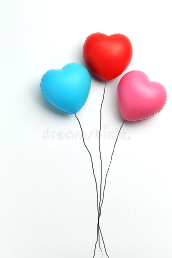 Color rubber hearts balloons creative photography isolated on white background,Valentine`s Day concept stock photo