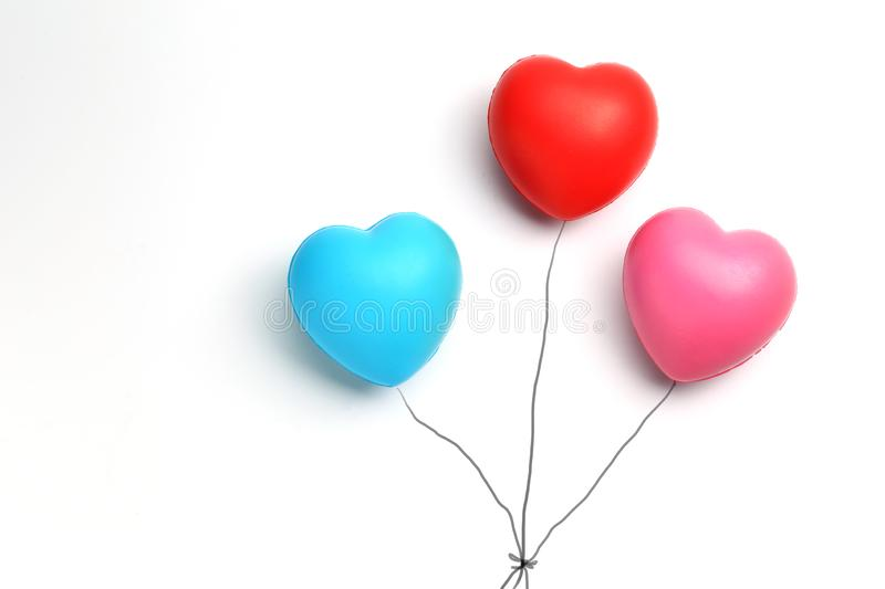 Color rubber hearts balloons creative photography isolated on white background,Valentine`s Day concept stock photos