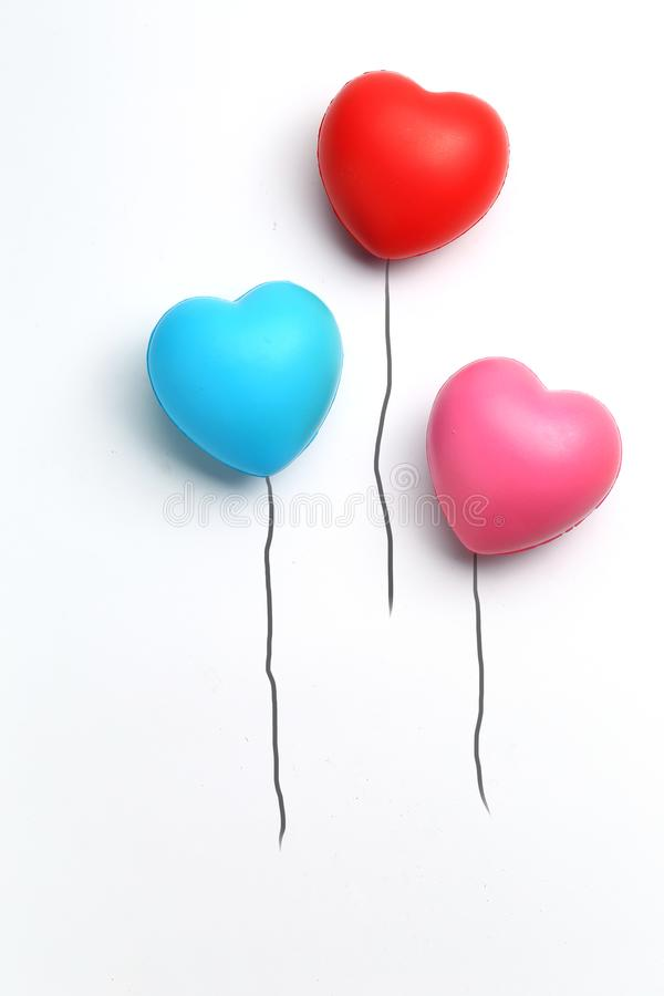 Color rubber hearts balloons creative photography isolated on white background,Valentine`s Day concept royalty free stock photo