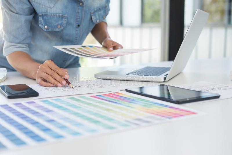 Color samples, colour chart, swatch sample, Graphic designer being selecting Color table and graphics tablet, pen at workplace wi. Th work example on wooden desk royalty free stock photography