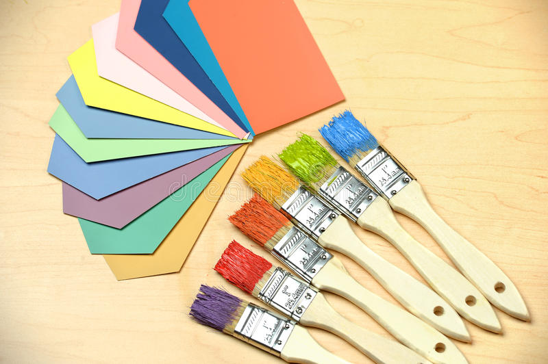 Color Samples and Paintbrushes stock image
