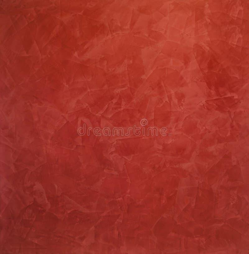 Color scarlatto, fondo rosso delle sbavature - gesso veneziano, rivestimento decorativo per le pareti fotografia stock