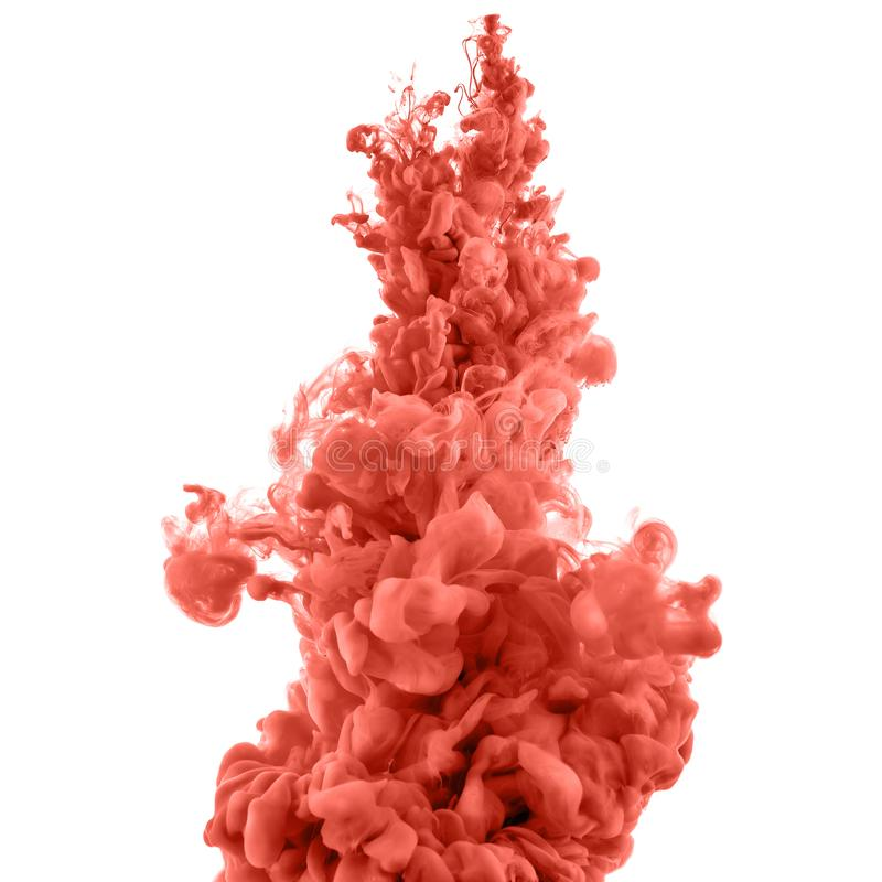 Color splashes of ink. Coral splashes of ink in water isolated on white stock photo