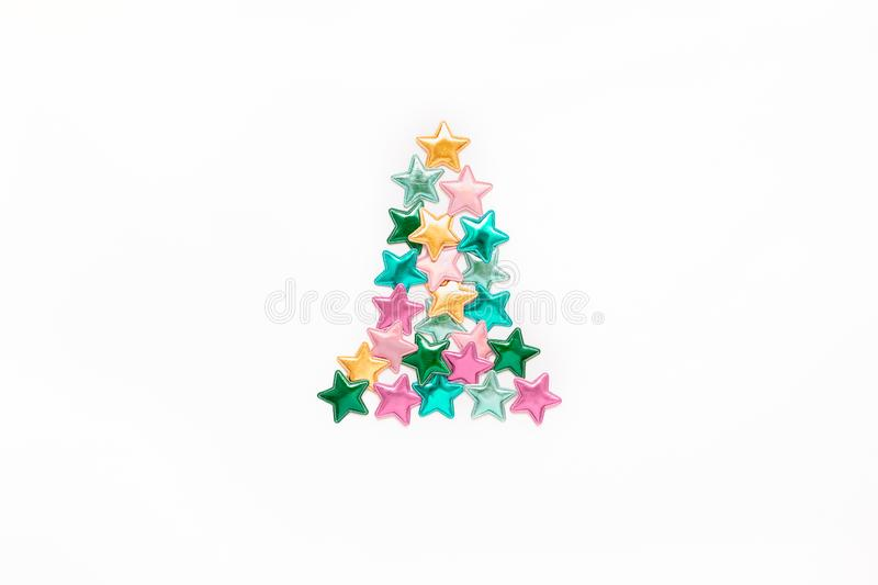 Color stars Christmas tree concept. Christmas composition. New Year pattern flat lay top view Xmas holiday celebration decorative color stars Christmas tree royalty free stock image