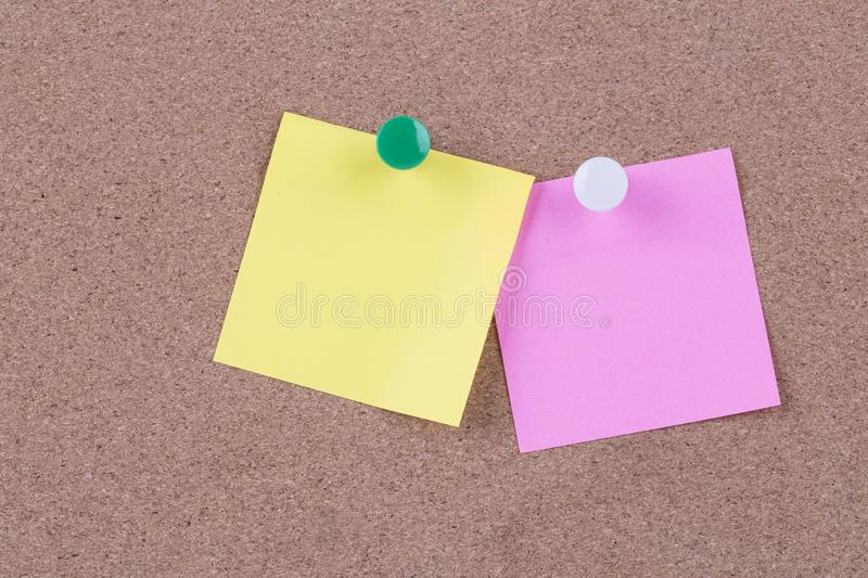 Color sticky note on cork board with blank notes, empty space for text.  stock photography