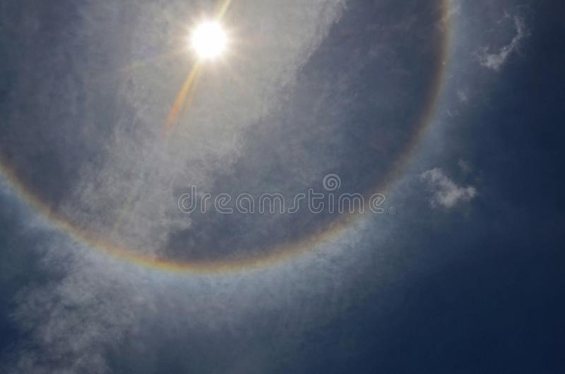 Color sun halo ring at noon on cloudy sly royalty free stock photography