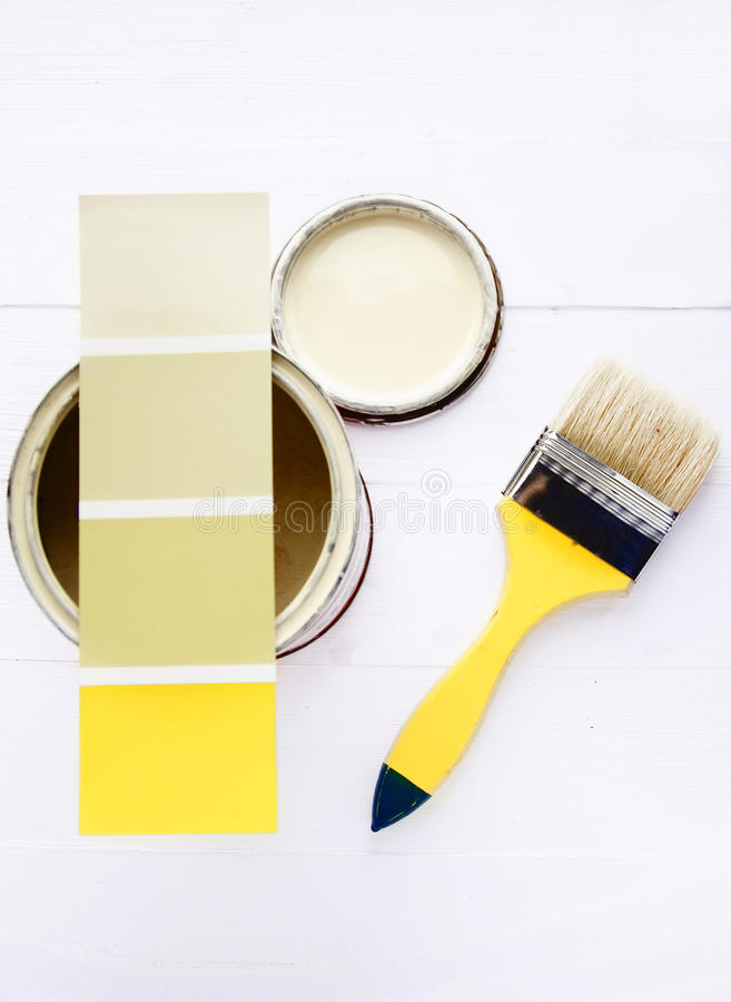 Color swatches. Brush and can of paint on a wooden table stock photography