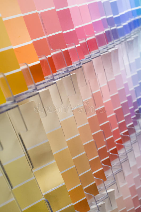 Color Swatches Background. Rows and columns of color swatches for use as background stock photo