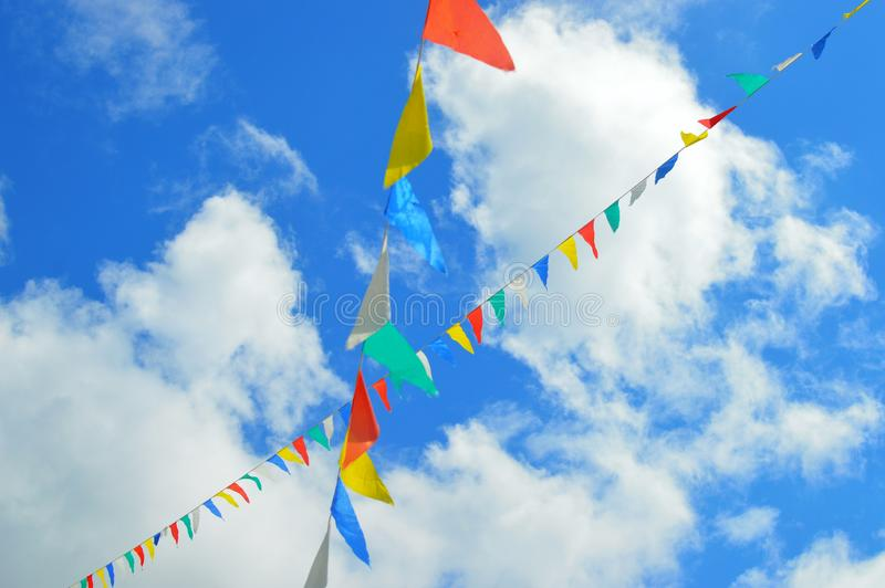 Colorful flags flying in the sky royalty free stock photography