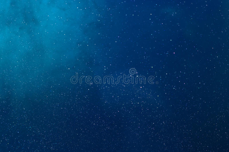 Color texture. water. sea. Deep blue. Colors dropped into liquid, photographed n in motion. Ink swirling in water. Cloud of silky ink in liquid. Colorful ink in royalty free stock photography
