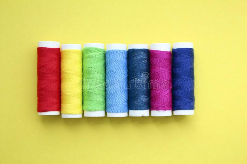 Color threads on yellow background stock images